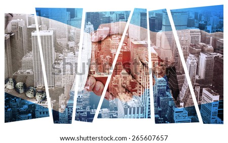 Side view of business peoples hands shaking against high angle view of city - stock photo
