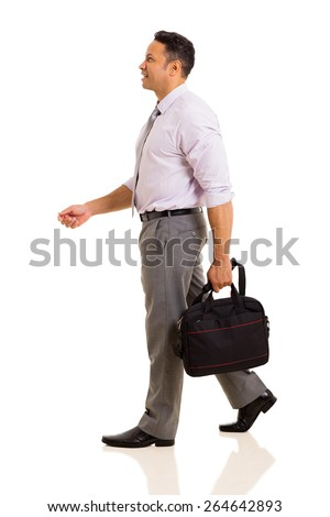 side view of businessman holding a bag walking isolated on white - stock photo