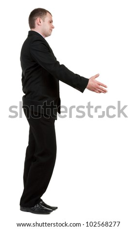 side view of Businessman  in black suit  handshake.   Isolated over white background. - stock photo