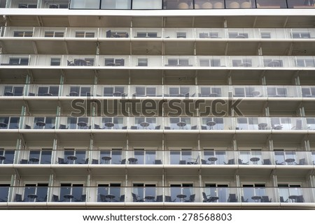 Side view of cabins on cruise liner. No people and ship are unrecognizable. - stock photo