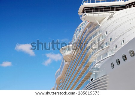 Side view of cruise ship on the blue sky background - stock photo