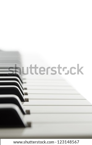 Side view of electronic piano keyboard keys. - stock photo