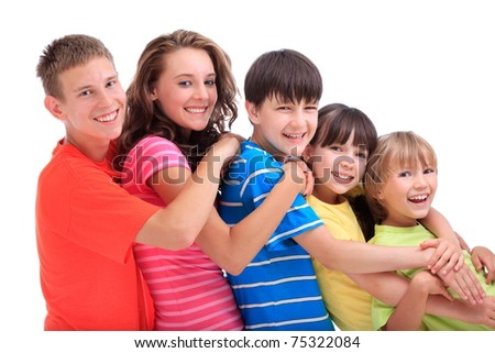Side view of five happy young brothers and sisters in ascending age and height with colourful clothes; white background. - stock photo