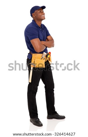 side view of happy african american handyman looking up - stock photo