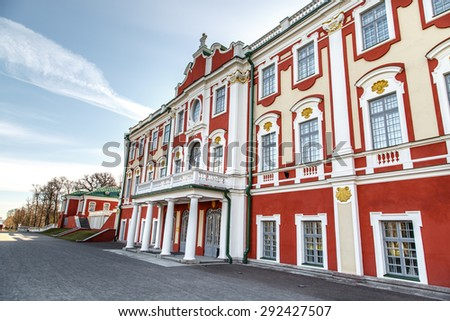 Side view of Kadriorg Palace in Tallinn Estonia, built by Tsar Peter the Great in 1725, on blue sky background. - stock photo