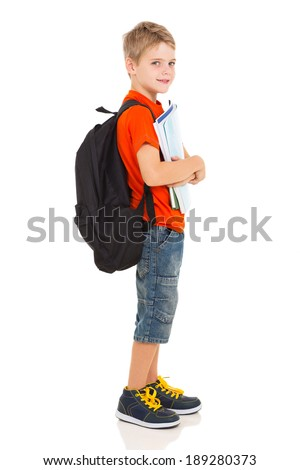 side view of male elementary school student with backpack - stock photo