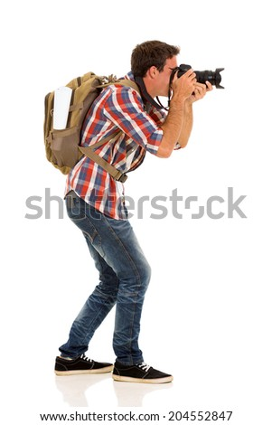 side view of male tourist taking pictures with digital camera - stock photo