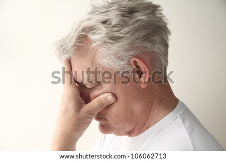 side view of man who is embarrassed or disappointed - stock photo