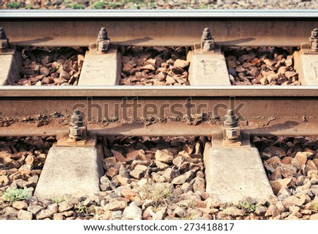 Side view of modern railway details, close-up photo with selective focus and shallow DOF - stock photo