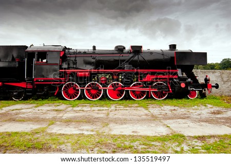 side view of old black, steam locomotive - stock photo