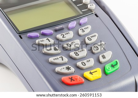 Side view of old credit card reader machine on white background - stock photo