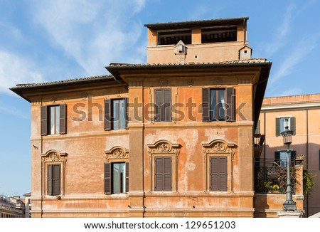 Side view of old roman house by Spanish steps in Rome housing restaurant - stock photo