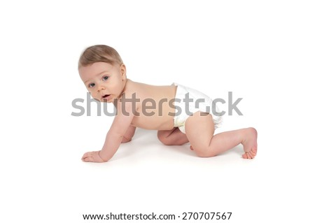 Side view of pretty serious crawling baby watching on you - stock photo