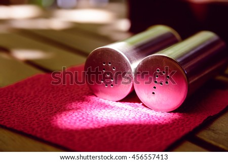 Side view of salt and pepper bottles - stock photo