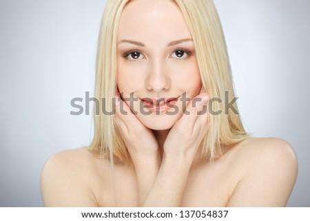 side view of sexy girl in white lingerie holding a huge decorative rose against red wine background - stock photo
