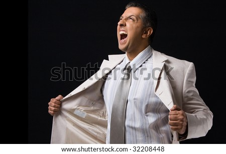 side view of shouting boss holding his coat - stock photo