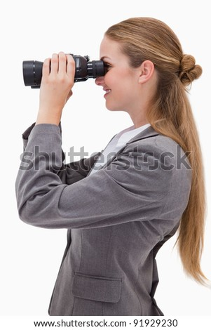 Side view of smiling bank employee with spyglasses against a white background - stock photo
