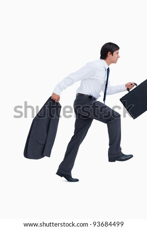 Side view of sprinting businessman with suitcase and jacket against a white background - stock photo