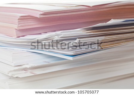 Side view of stack of papers - stock photo