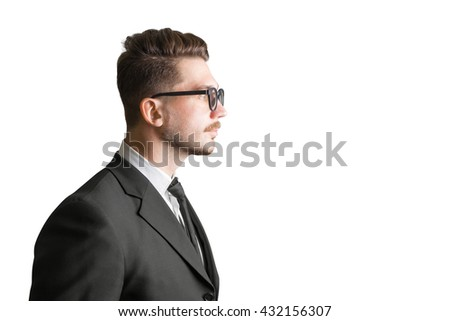 Side view of stylish bearded businessman in glasses isolated on white background - stock photo