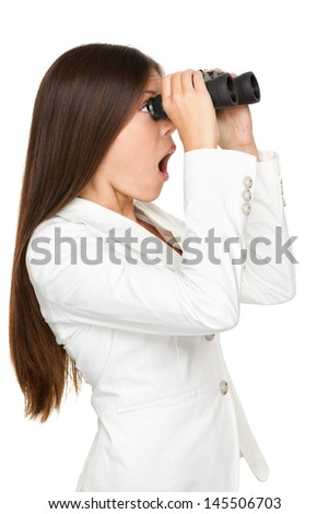Side view of surprised young businesswoman looking through binoculars isolated over white background - stock photo