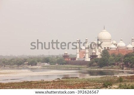 Side view of Taj Mahal along with river Yamuna - stock photo