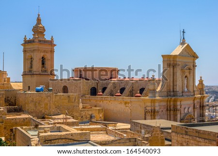 Side view of the Cathedral of Assumption in the middle of the citadel in Gozo, Malta. - stock photo