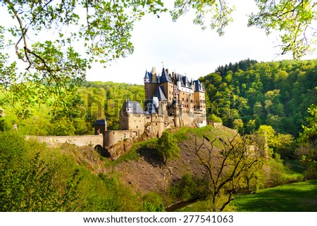 Side view of the Eltz castle from the forest Muenstermaifeld, Mayen-Koblenz, Rhineland-Palatinate, Germany Europe - stock photo