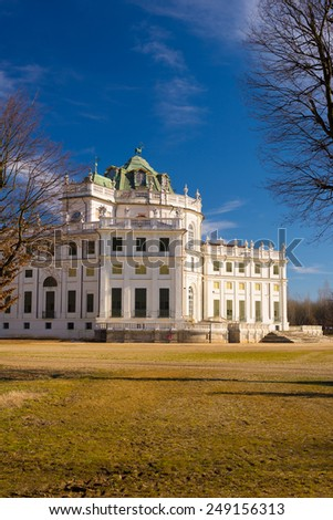 Side view of the Palazzina di Caccia di Stupinigi exterior, royal residence Savoy and hunting lodge in the eighteenth century, now included in the UNESCO heritage list. Torino, Piedmont, Italy. - stock photo