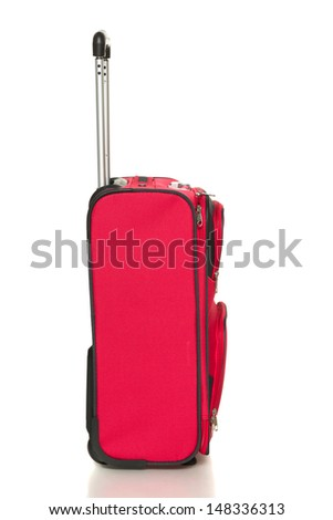Side view of the rad suitcase isolated on white background - stock photo