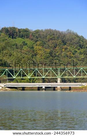 side view of truss structure railroad bridge - stock photo