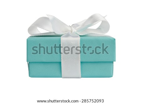 Side view of turquoise isolated gift box with white ribbon on white background with path - stock photo