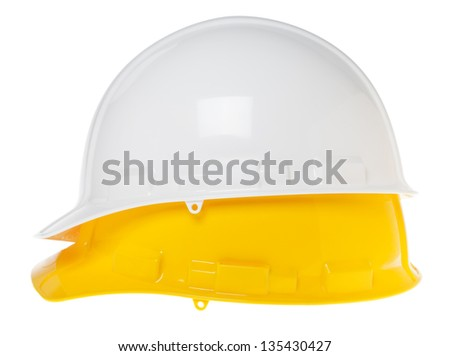 Side view of two hard hats, white on top of yellow, isolated on white background. - stock photo