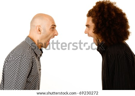 Side view of two young men, one with bald head and one with afro hairstyle, arguing. White studio background. - stock photo