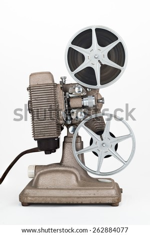 Side view of Vintage 8 mm Movie Projector with Film Reels. Film is threaded through Projector. - stock photo