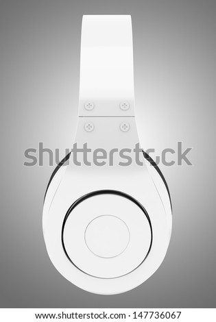 side view of white and black wireless headphones isolated on gray background - stock photo