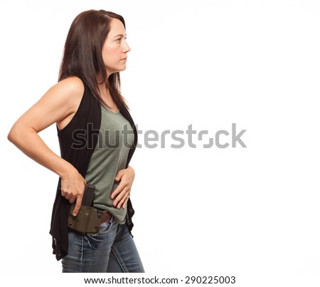 Side view of Woman Practicing Gun Safety   Attractive female shooter holding handgun against white background. - stock photo