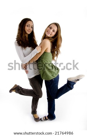 side view of young beautiful females against white background - stock photo