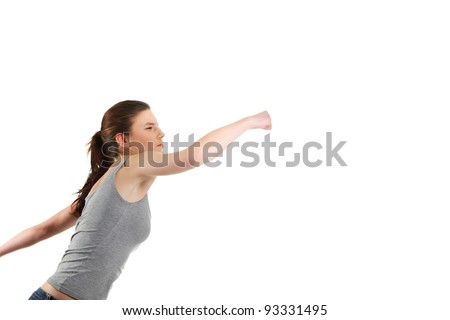 Side view of young woman with fists up punching something,  isolated on white - stock photo