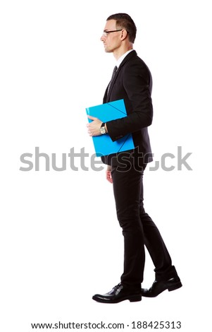 Side view portrait of a businessman in glasses with blue folder over white background - stock photo