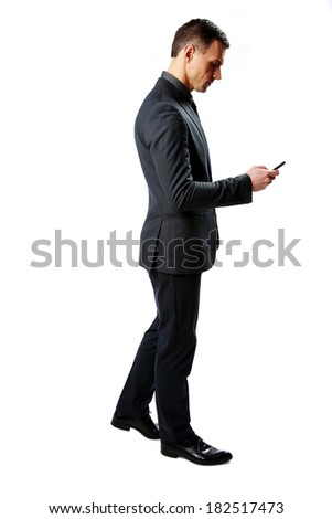 Side view portrait of a businessman using smartphone isolated on a white background - stock photo