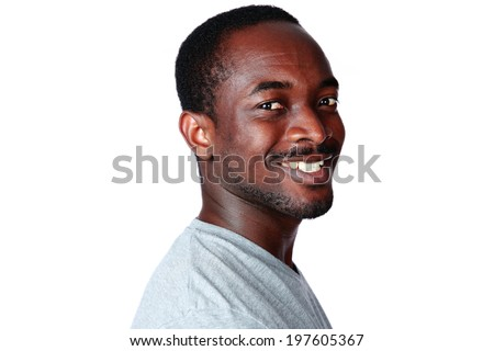 Side view portrait of a happy african man looking at camera over white background - stock photo