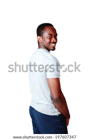 Side view portrait of a happy african man over white background - stock photo