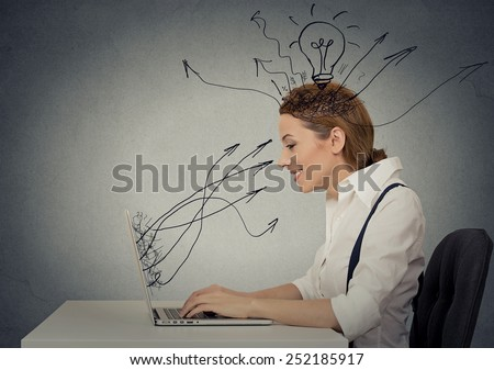 Side view profile attractive happy business woman working on laptop computer isolated grey wall background. Internet creativity network concept  - stock photo