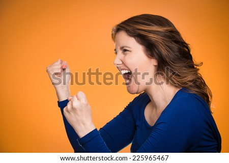 Side view profile portrait beautiful angry woman screaming isolated on orange background. Negative human emotions, face expression, feelings, anger management problems  - stock photo
