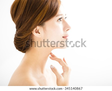 side view young smiling  woman with clean face  - stock photo