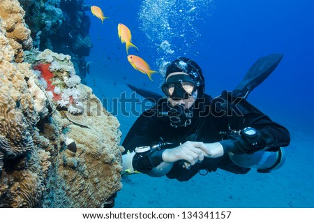 sidemount scuber diver in clear blue ocean - stock photo