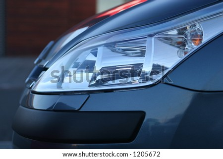 sideview of halogen headlight on a new car - stock photo