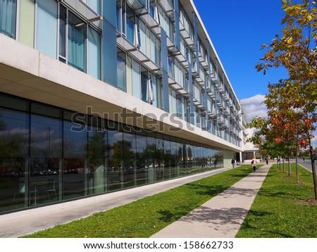 sidewalk beside college building - stock photo