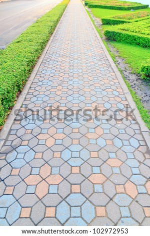 Sidewalk made of bricks in various colors. - stock photo